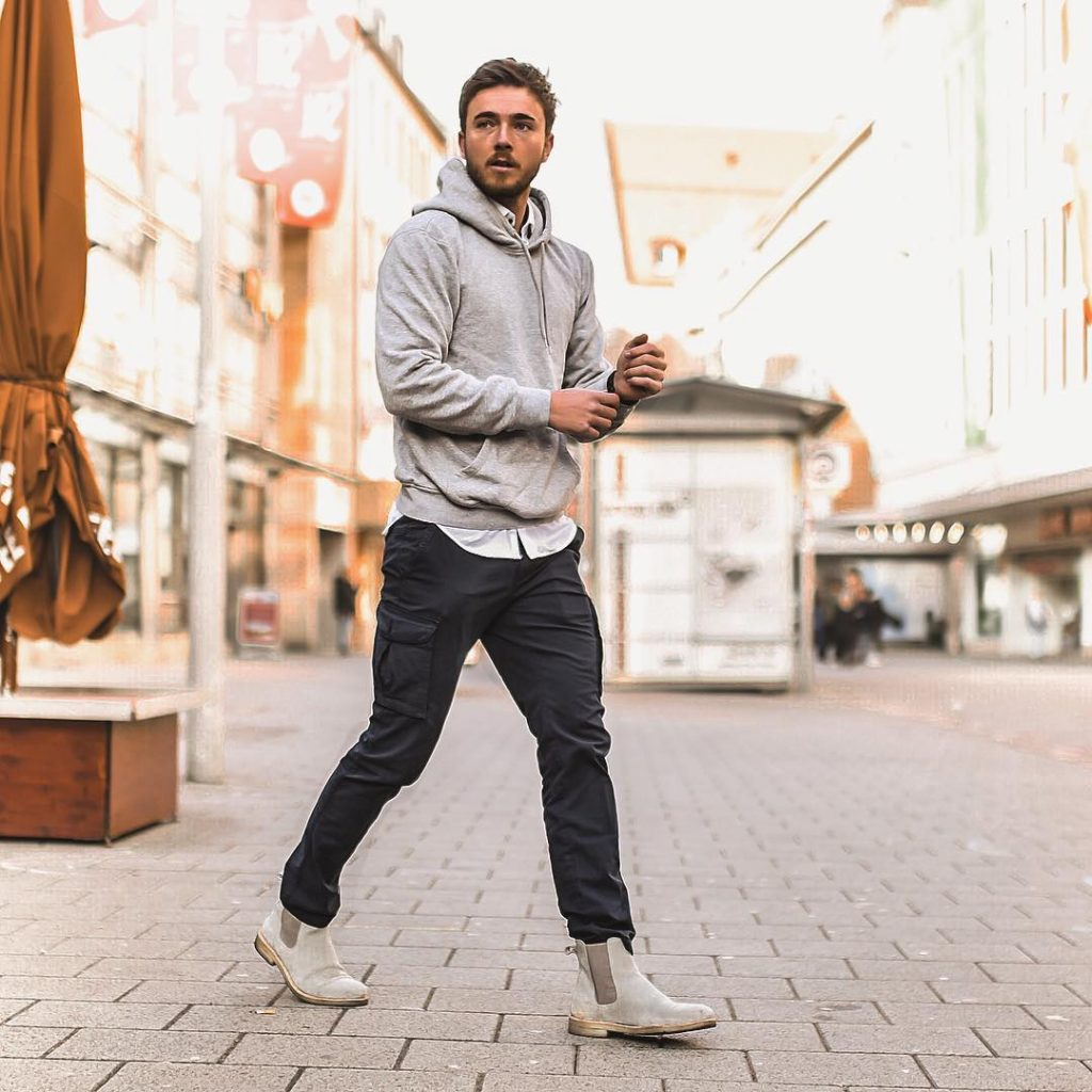 White shirt, grey hoodie sweater, dark trouser and grey chelsea boots