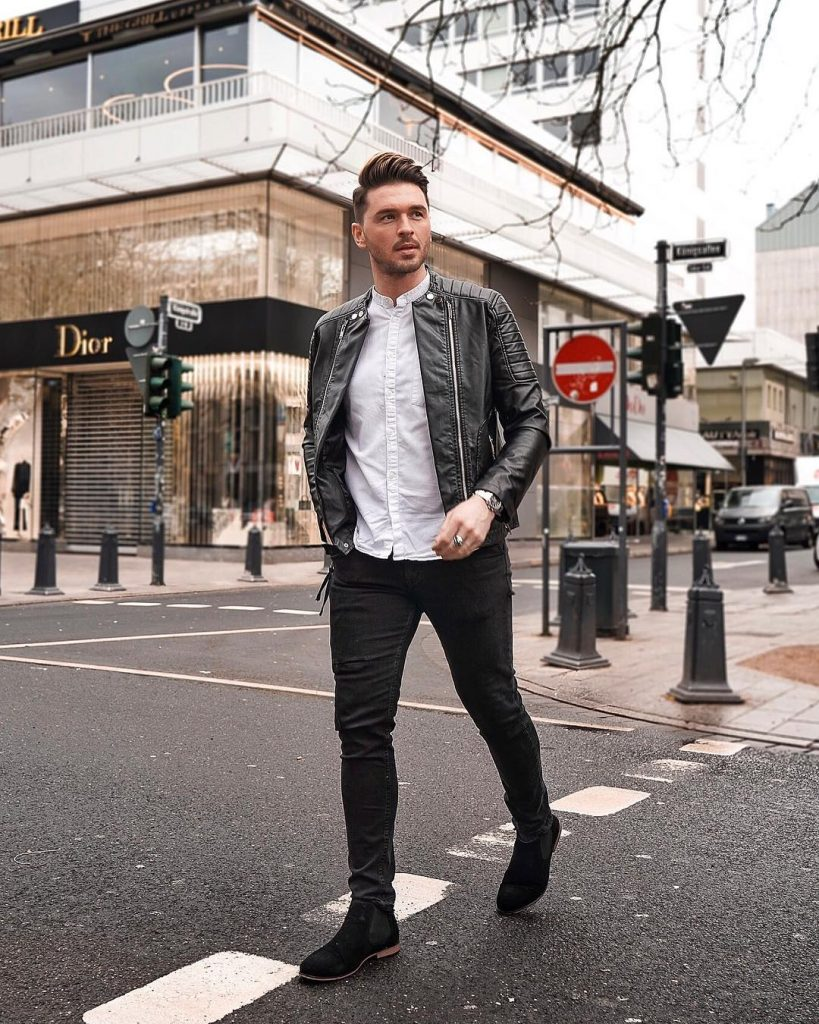 Black leather jacket, mandarin collar white shirt, black jeans and, Chelsea boots