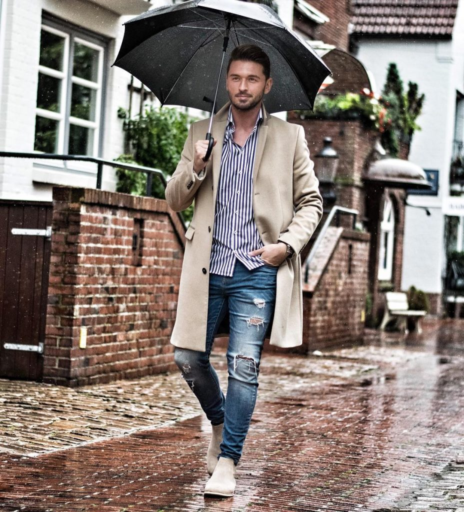 Pinstripe shirt, light brown overcoat, blue jeans and Chelsea boots