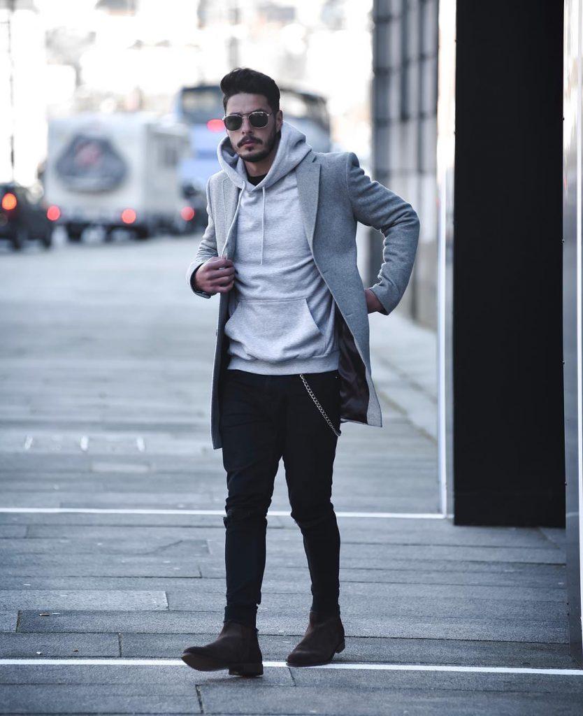 Gray wool overcoat, light gray hoodie sweater, dark trouser and boots.
