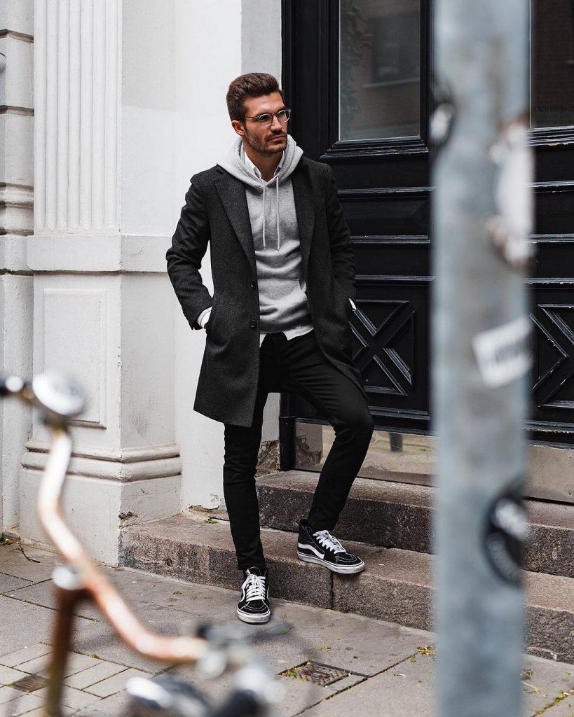 Black overcoat, gray hoodie sweater, white shirt, black dress pants and sneaker