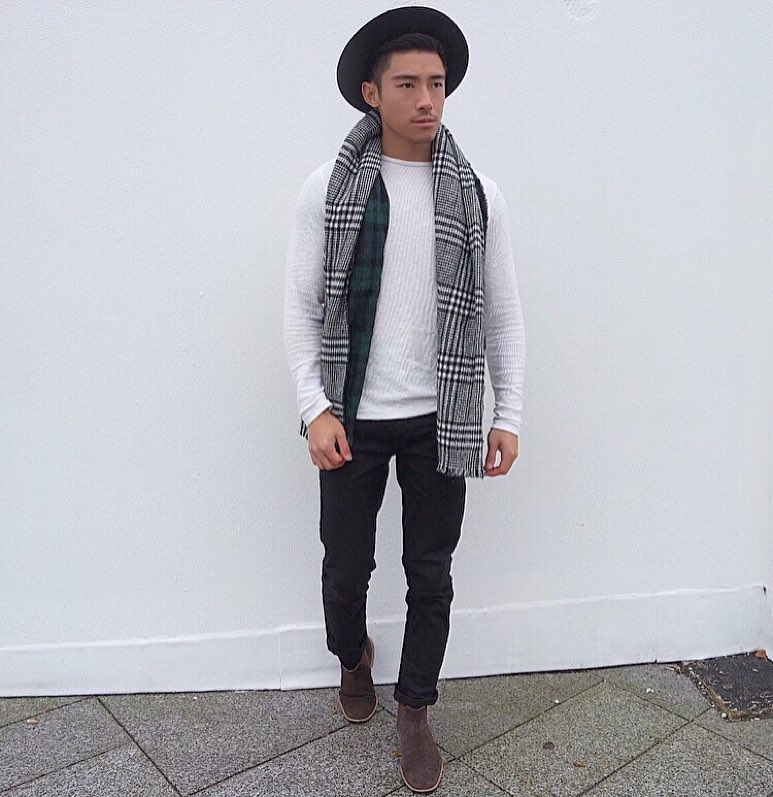 Fedora hat, sweater, scarf, dark trouser, and Chelsea boots