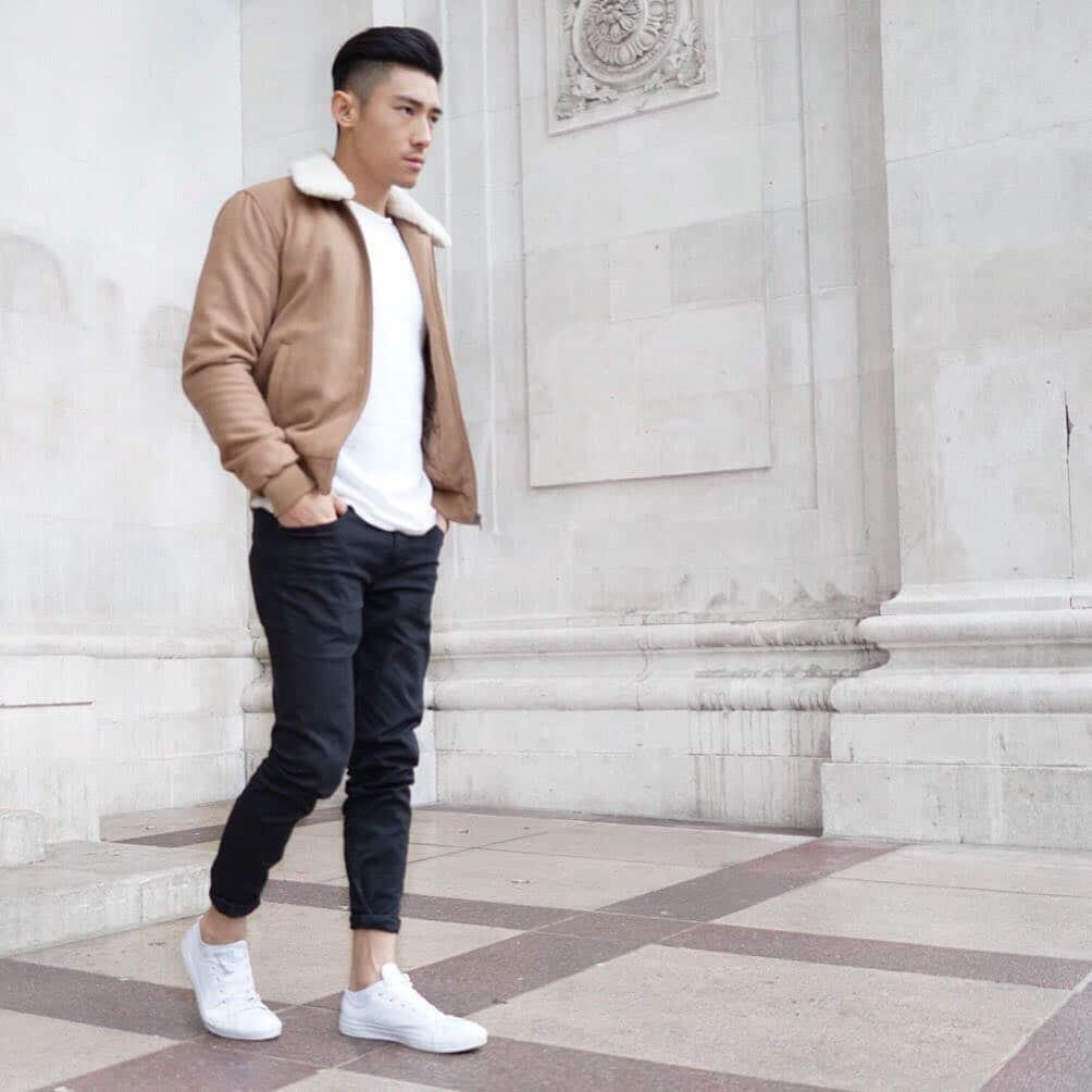 Sheepskin bomber jacket, white tee, black pants, and white sneaker
