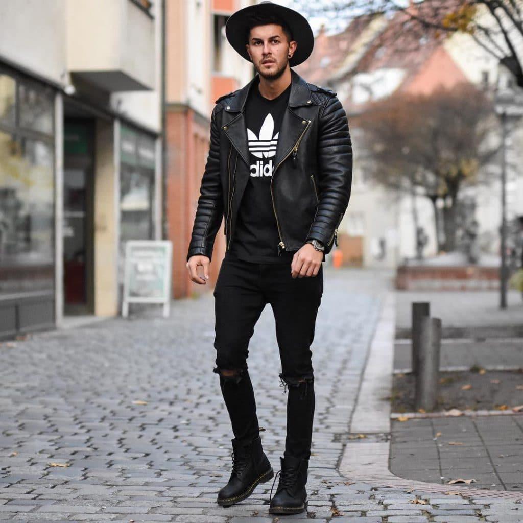 Black tee, fedora hat, black leather biker jacket, dark jeans and boots