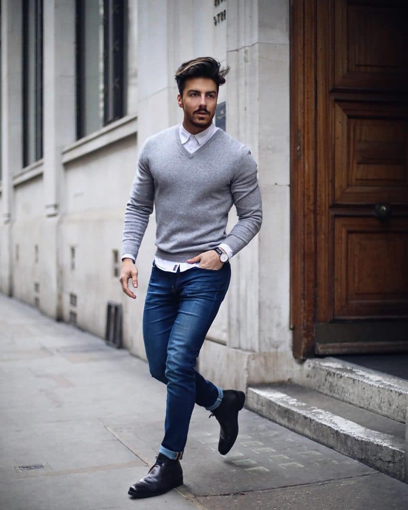 White shirt, gray sweater, blue jeans and leather boots