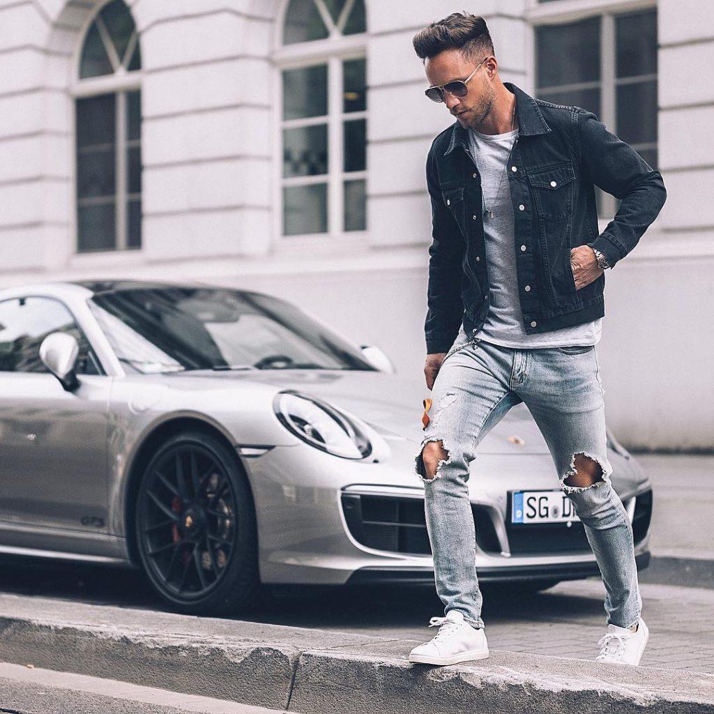 Dark denim jacket, grey tee, jeans, and white sneaker