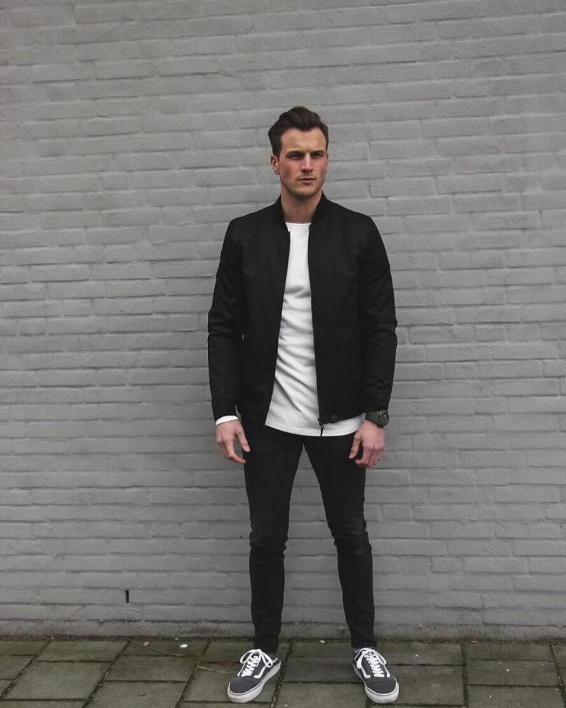 White tee, black bomber jacket, black pants and gray sneaker
