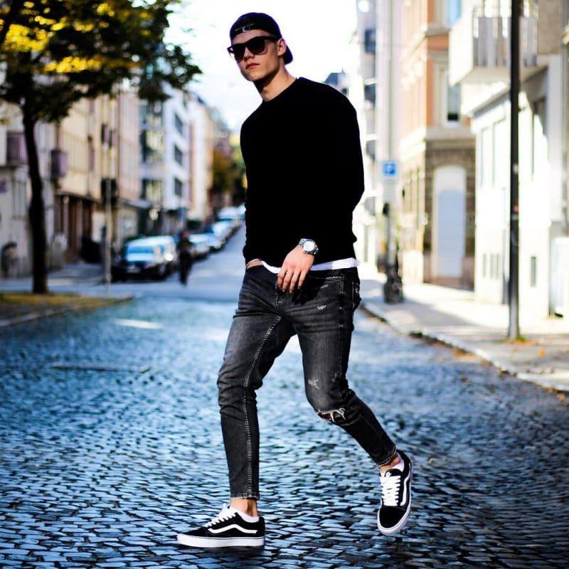 Baseball cap, black tee, white base layer tee, dark jeans, and black sneaker