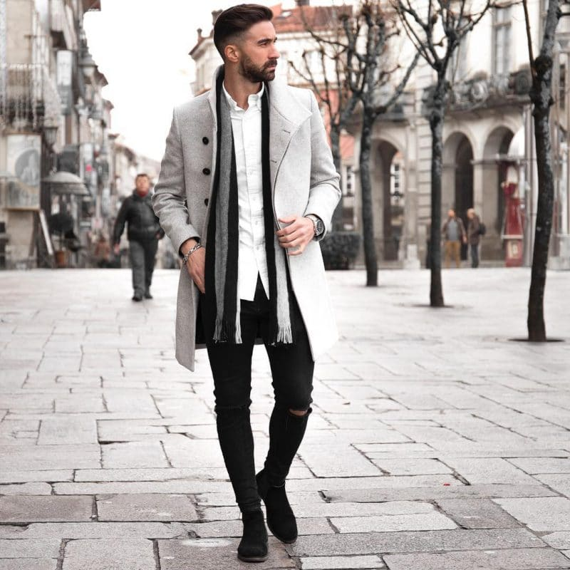 Single breasted wool coat, white shirt, dark jeans, scarf, and boots