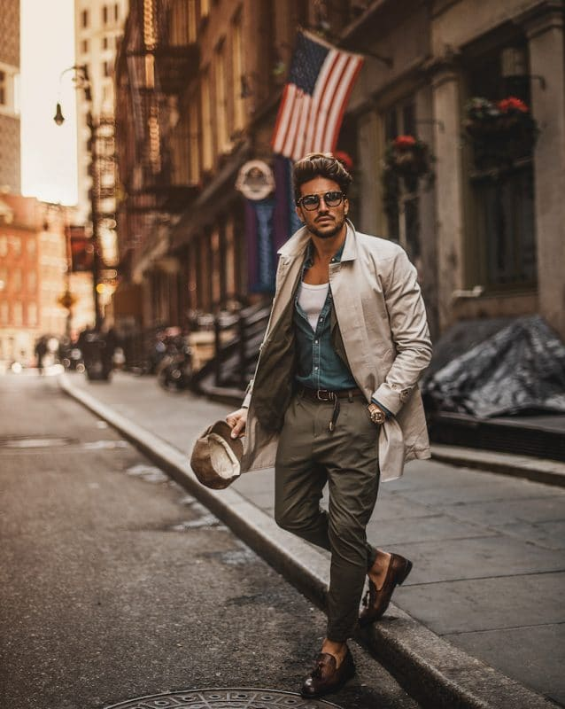 Tan overcoat, denim shirt, singlet, brown trouser and loafers