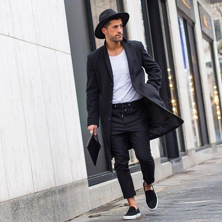 Fedora hat, black overcoat, black trouser and slip on shoes
