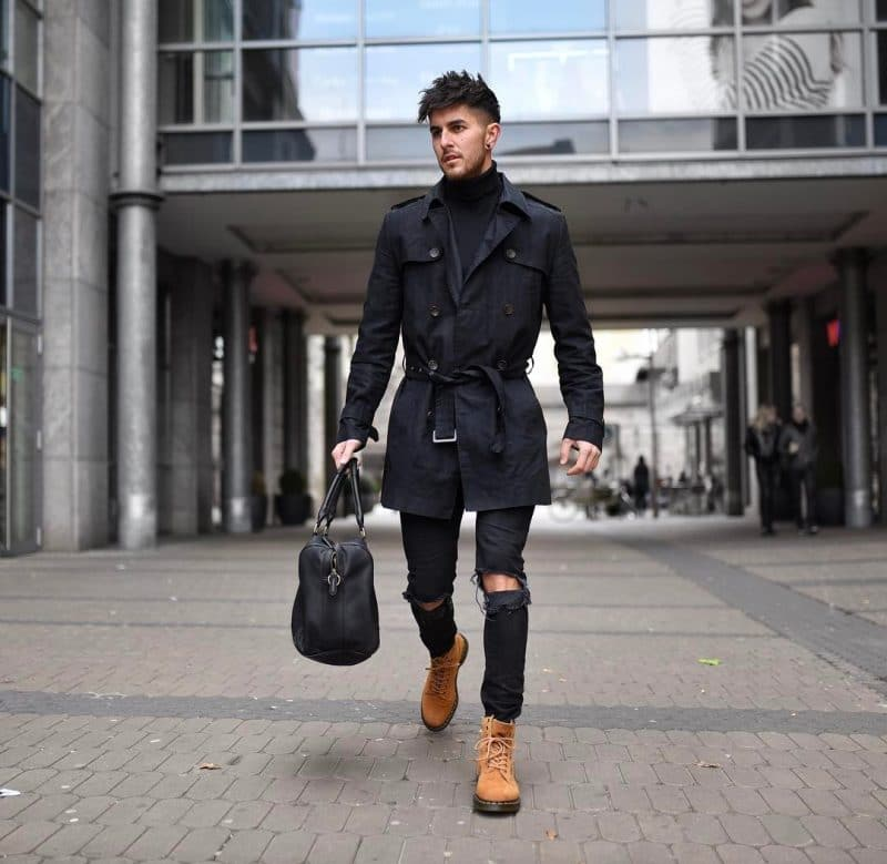 Turtleneck tee, black trench coat, ripped jeans and brown jungle boots