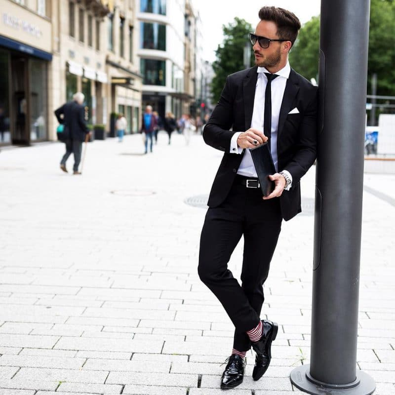 Black suits, white shirt, skinny tie, leather belt, print socks and oxford leather shoes