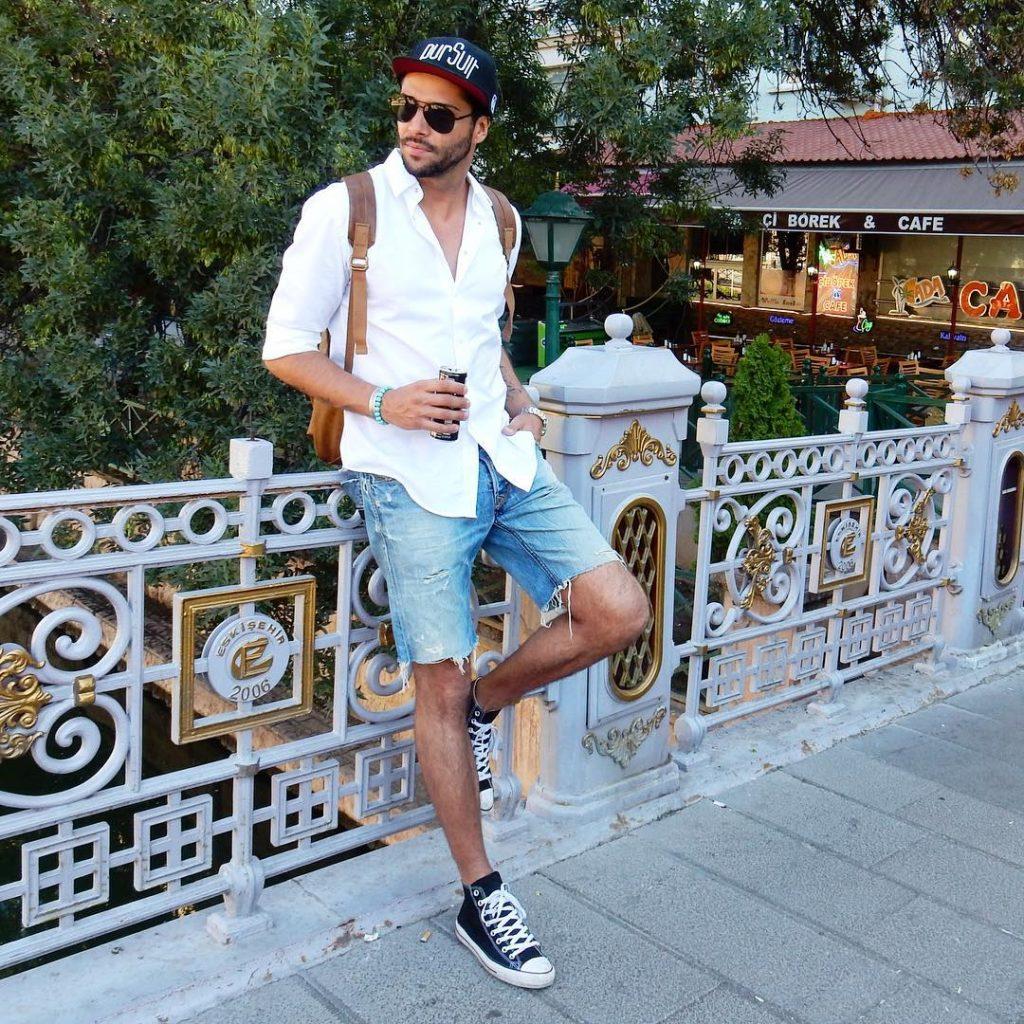 White shirt, short jeans, sneaker, snapback hat