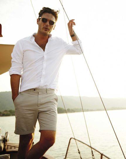 White shirt, sunglasses. beige short pants