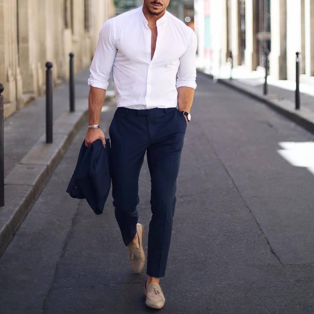 Mandarin collar white button down shirt, blue suit, and suede loafers