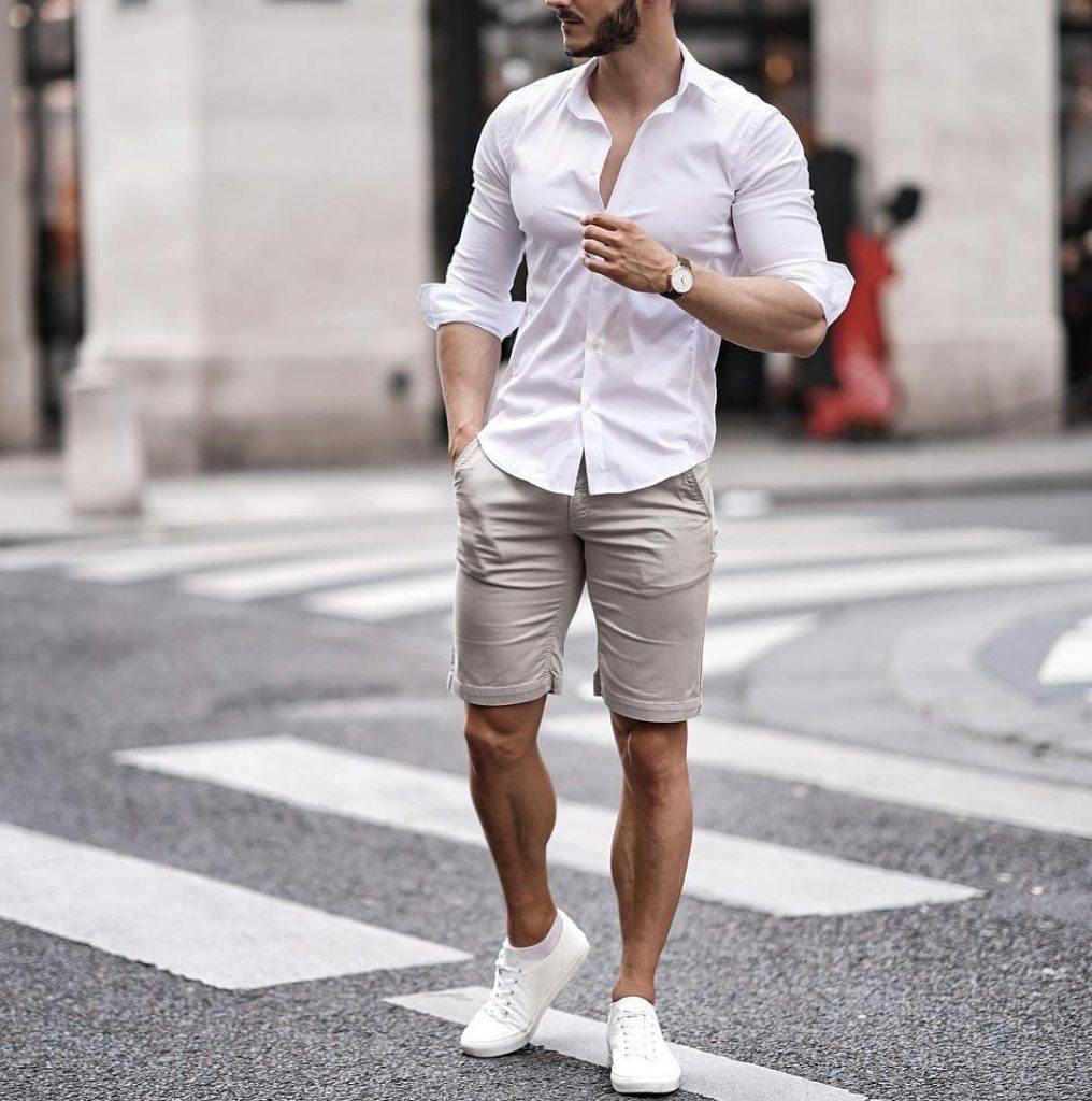 White button-down shirt, beige short pants, and white sneaker
