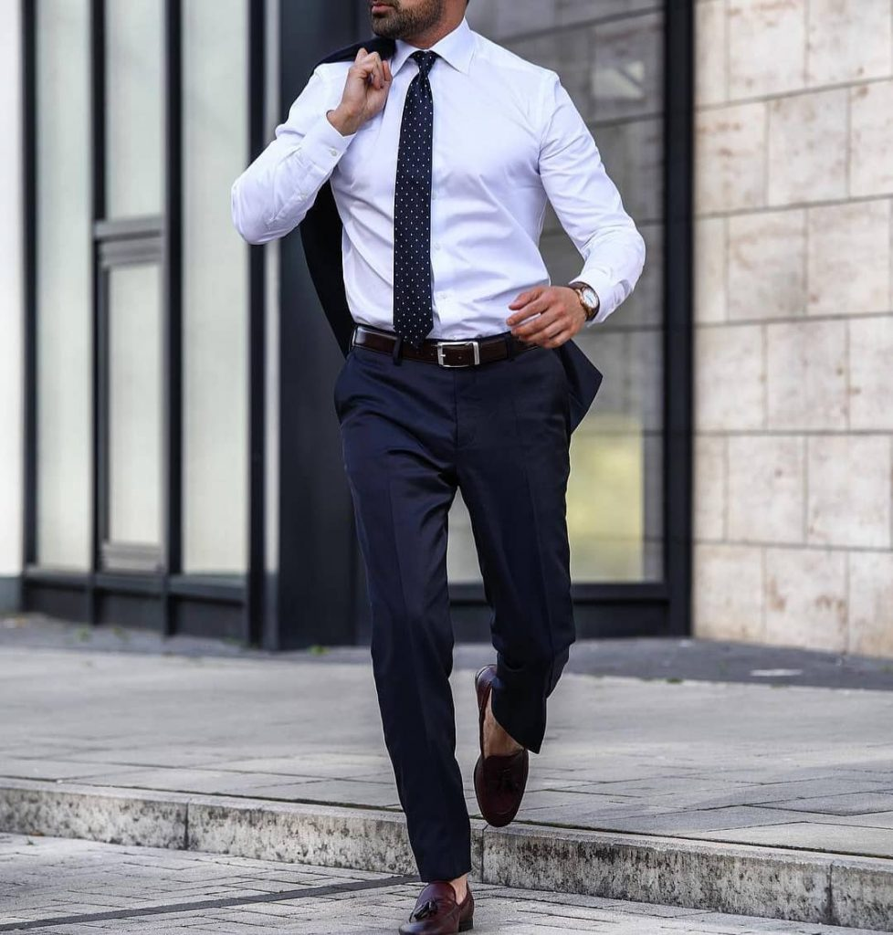 Business white shirt, dark blue suit, spot tie, leather belt and loafers