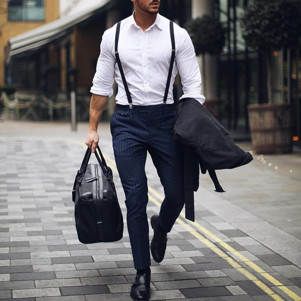button-down business white shirt, slim suspenders, pinstripe dress pants, and double monk strap shoes