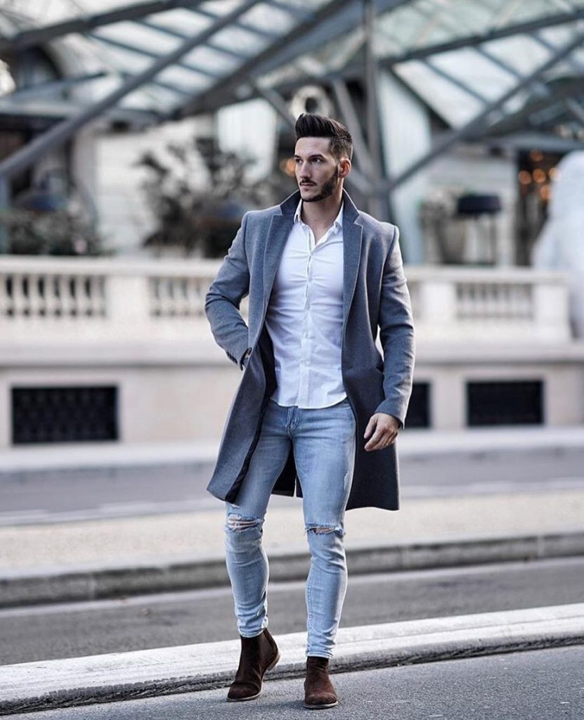 Gray wool overcoat, white shirt, blue ripped jeans, and Chelsea boots