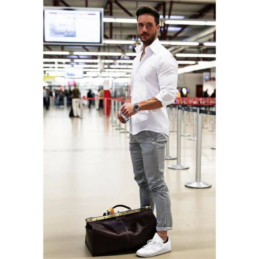 White button-down shirt, gray trousers, and white sneaker
