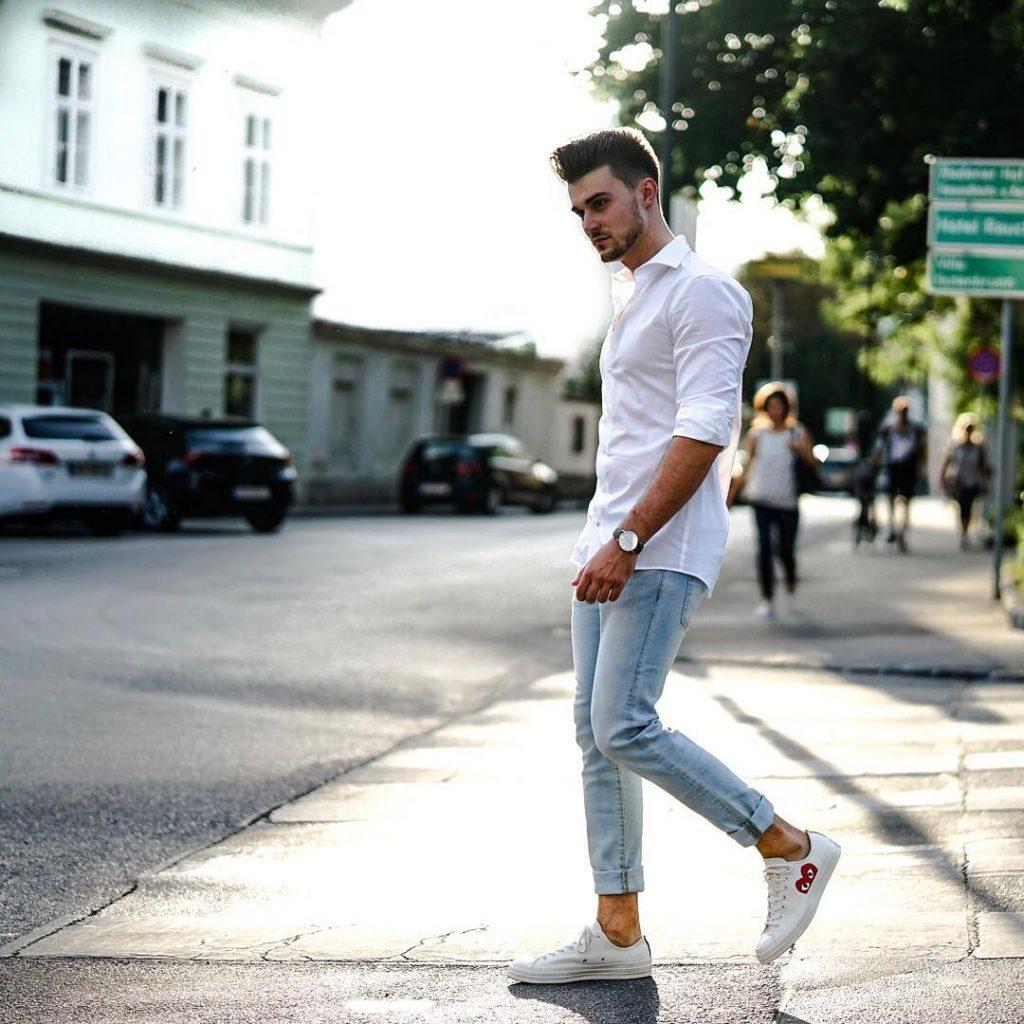 White shirt, light blue jeans, and white sneaker