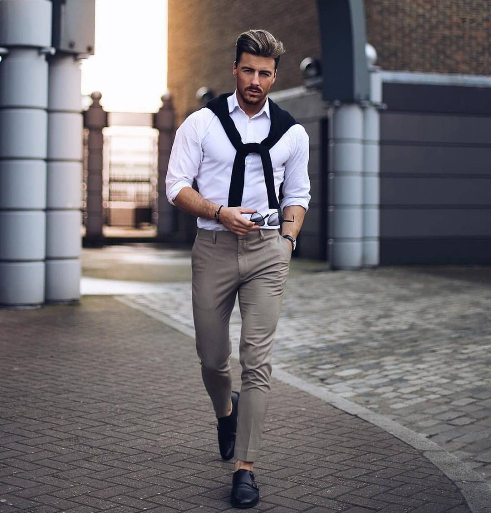 White button-down shirt, dark brown dress pants, black tee (on neck), and double monk strap shoes