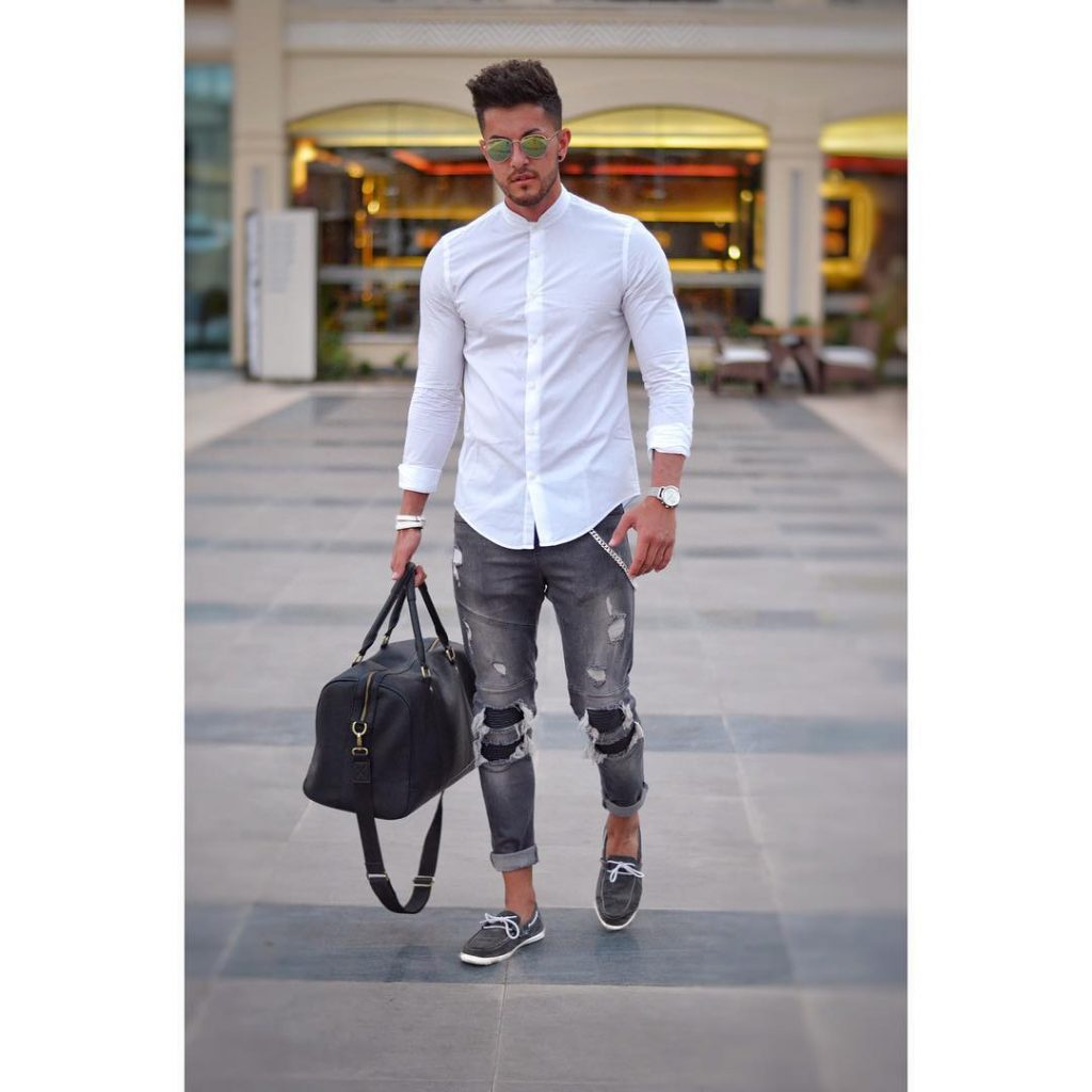 Mandarin collar white shirt, black jeans, leather bag, and gray boat shoes