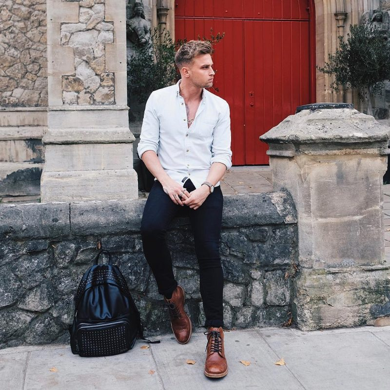 White button-down shirt, dark blue jeans, brown leather boots 1