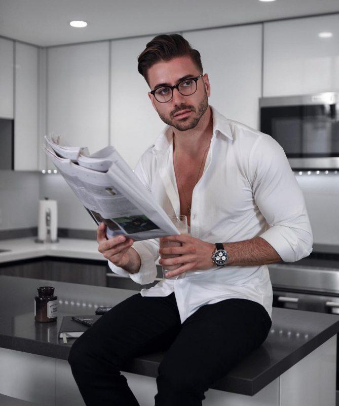 White button-down shirt, watch, black dress pants 1