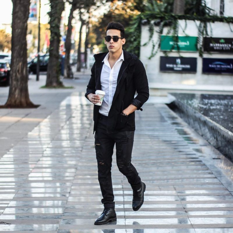 White shirt, jacket, black ripped jeans, leather boots 1