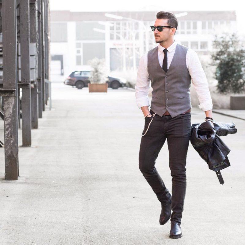 Gray suit vest, white shirt, black tie, jeans, leather boots 1