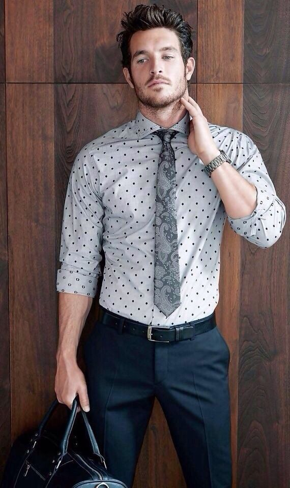 Dotted shirt, printed tie, dark blue dress pants, and black leather belt