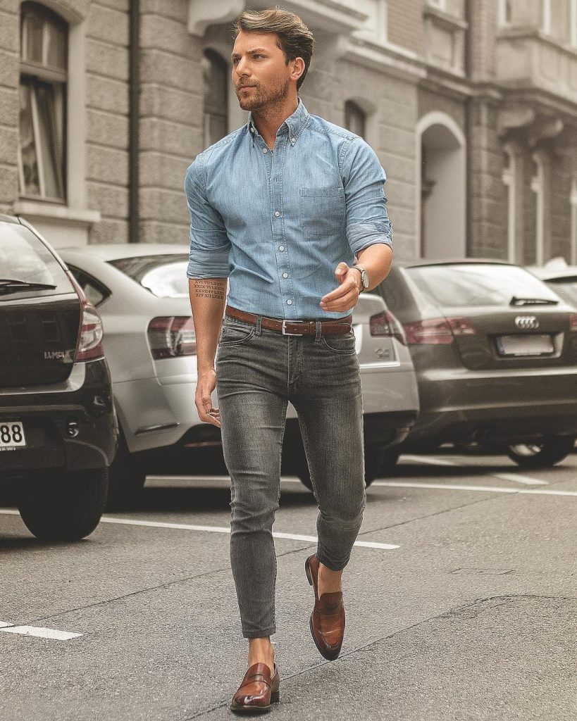 Denim shirt, gray jeans, brown leather belt, and loafers