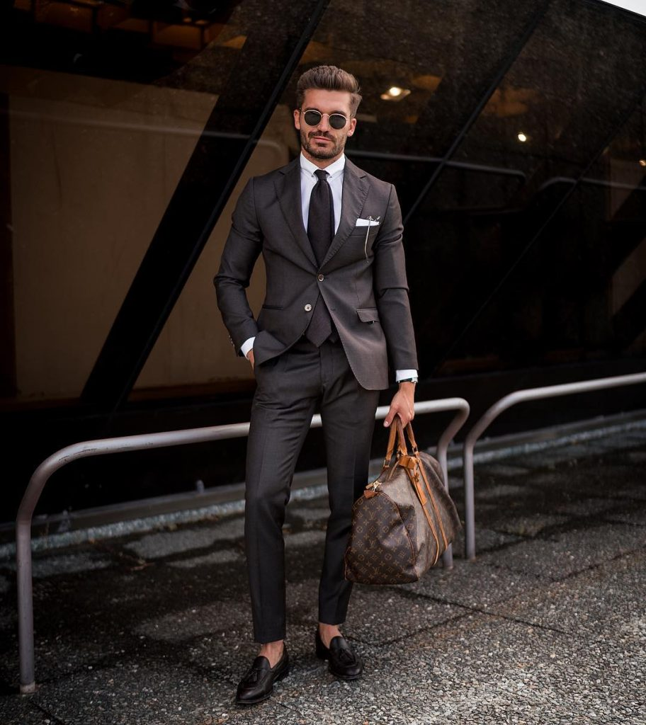 Black suit, white shirt, black tie, and leather loafers