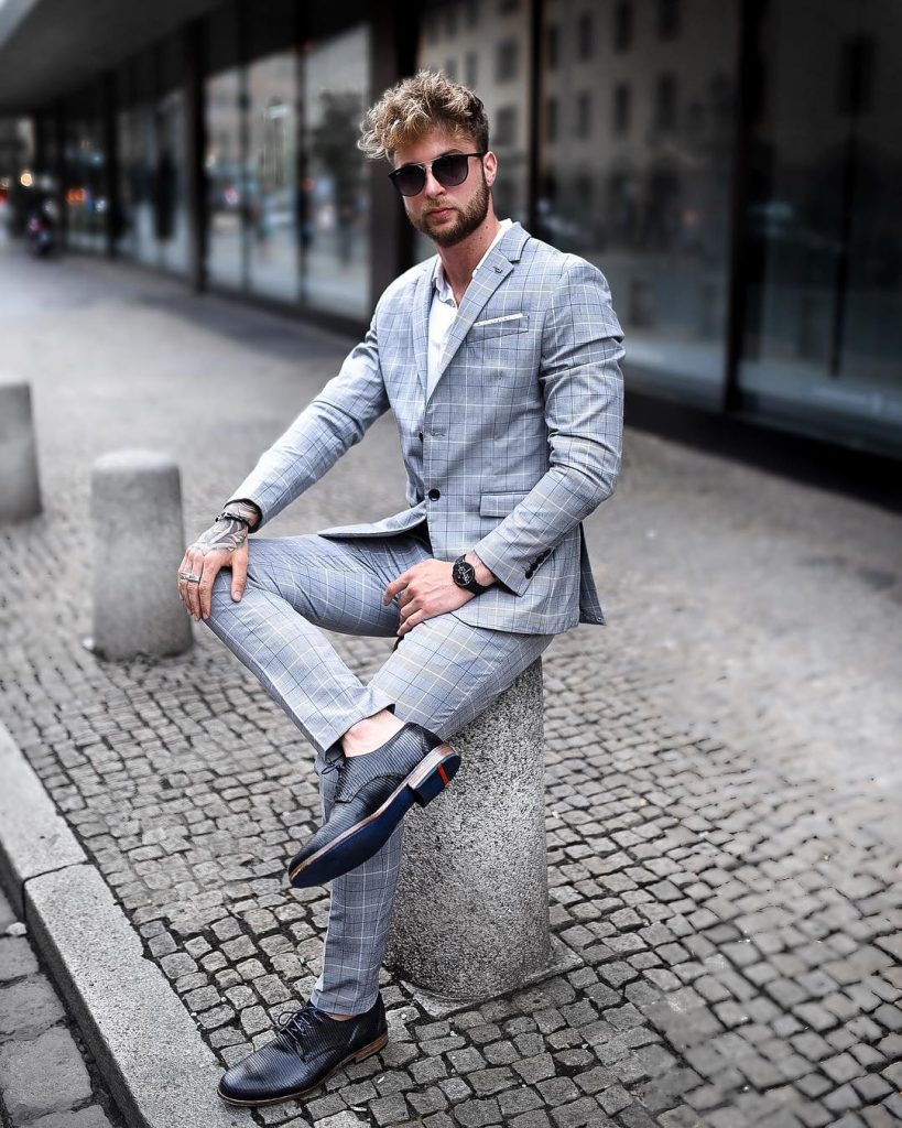 Gray checked suit, white button-down shirt, and leather shoes