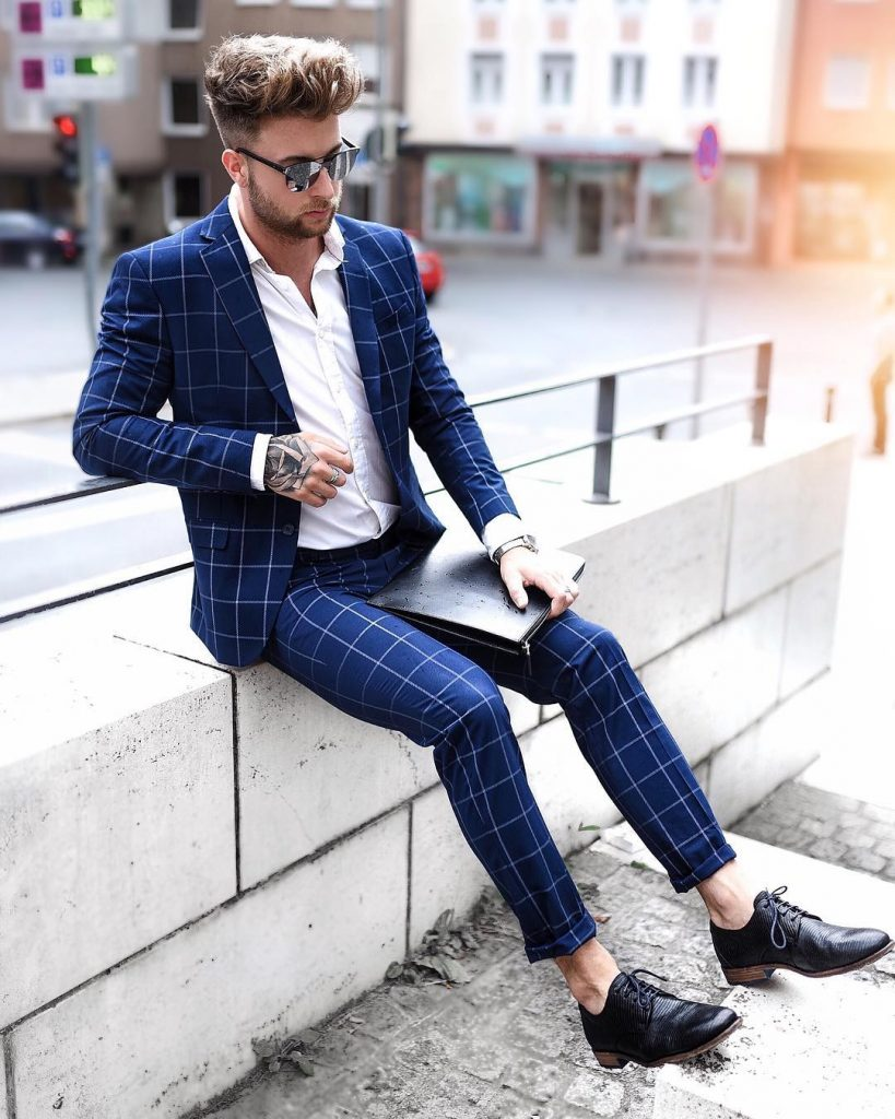 Blue checked suit, button-down white shirt, and derby dress shoes