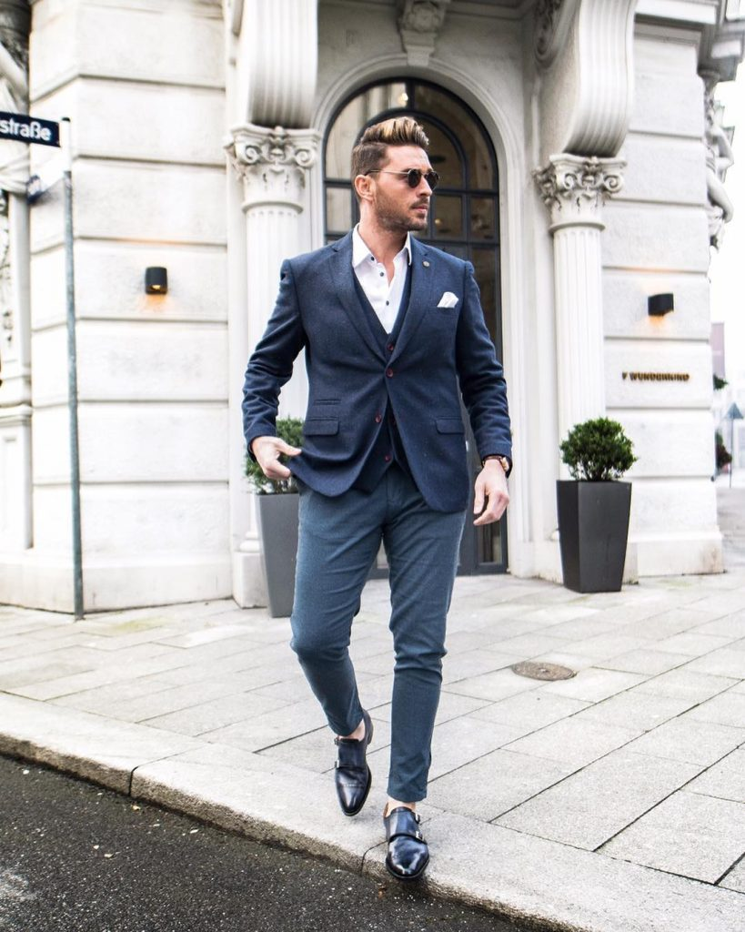 Blue suit with a vest, white shirt, and double monk strap shoes