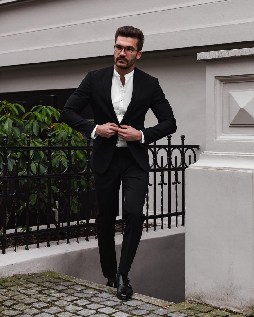 Black suit, mandarin collar white shirt, and double monk strap shoes
