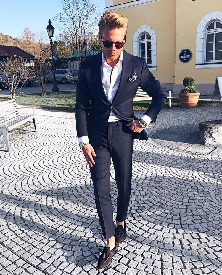 Black suit, white shirt, and suede loafers