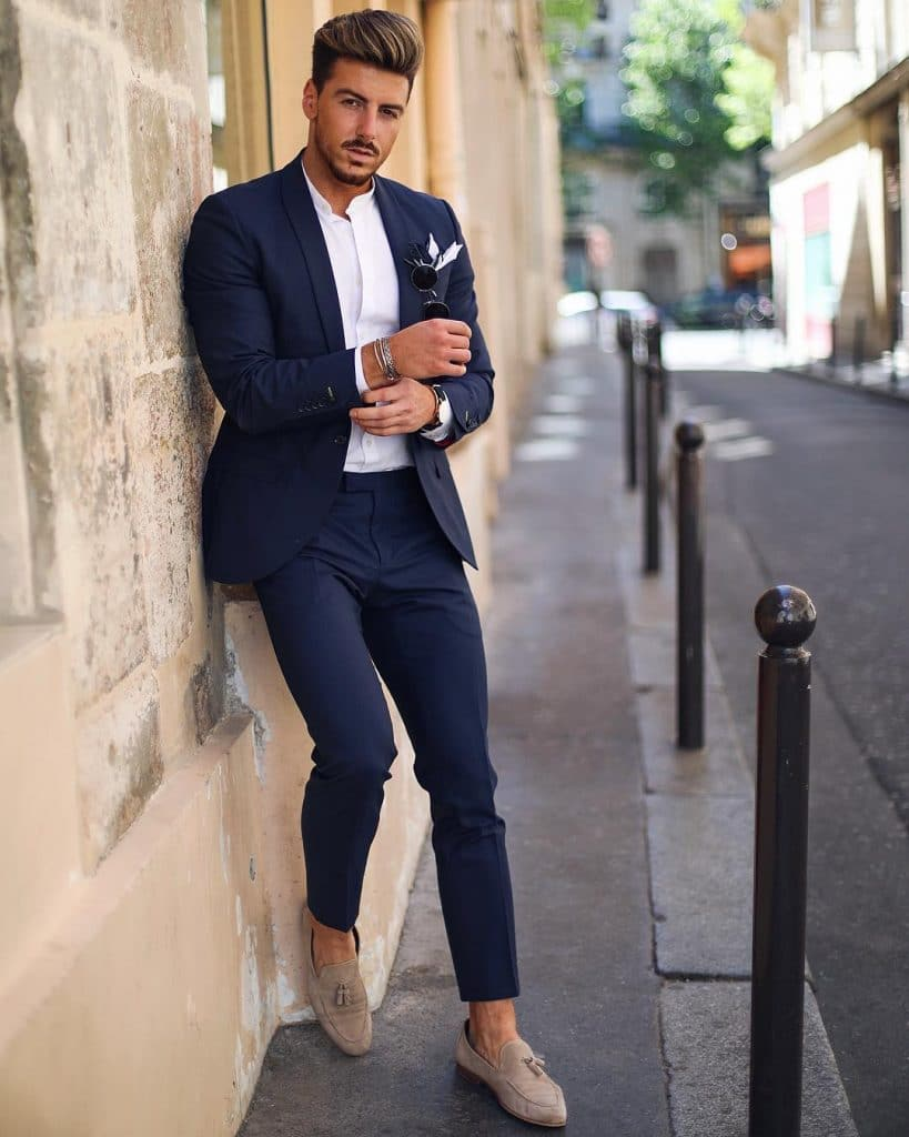 Dark blue suit, mandarin collar white shirt, and loafers