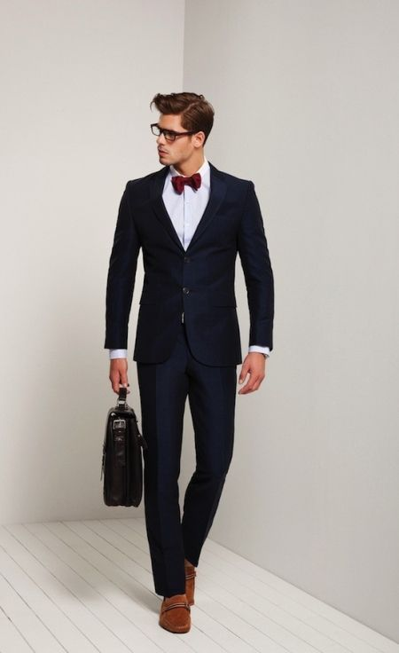 lack suit, red bow tie, white shirt, and loafers