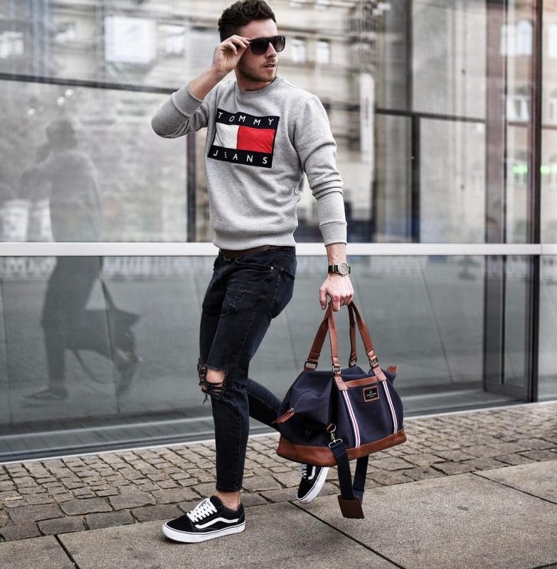 Gray printed sweater, black jeans, sunglasses, black sneaker and hand bag