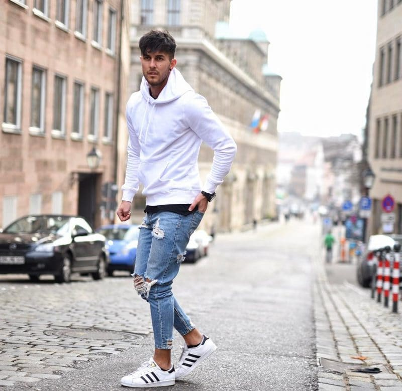White hoodies, blue jeans and sneaker