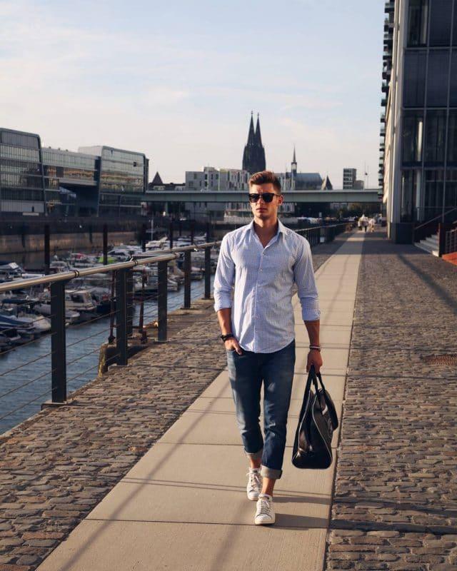 Checked shirt, blue jeans, white sneaker and handbag
