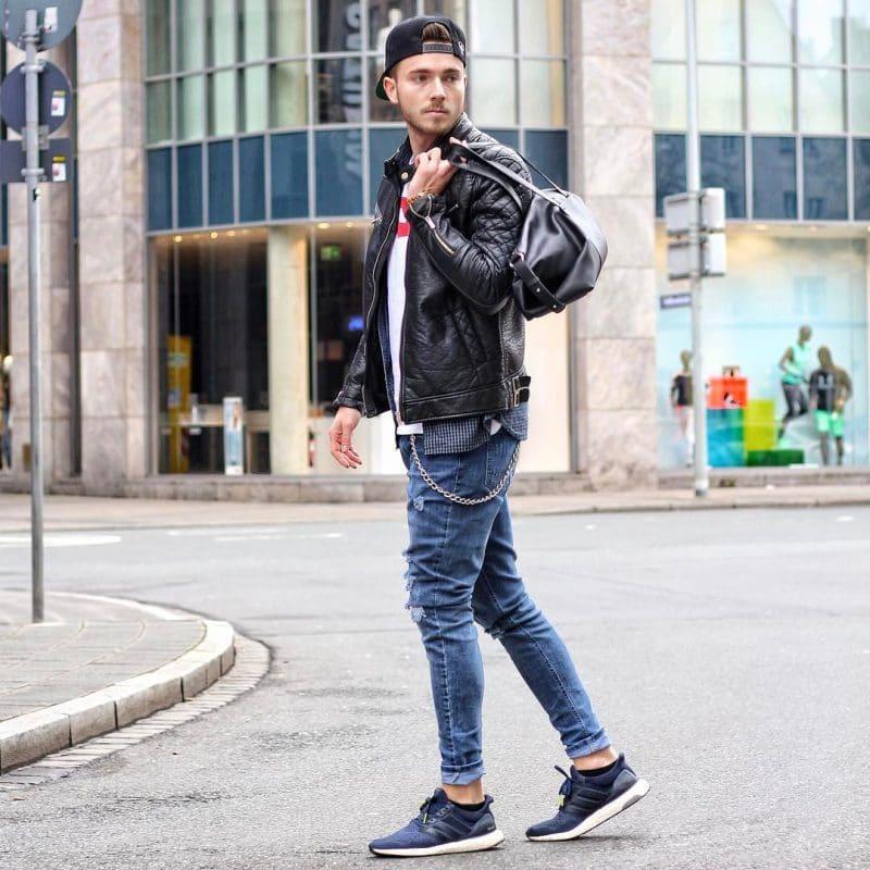 Leather jacket, tee, jeans, sneaker, snapback hat.