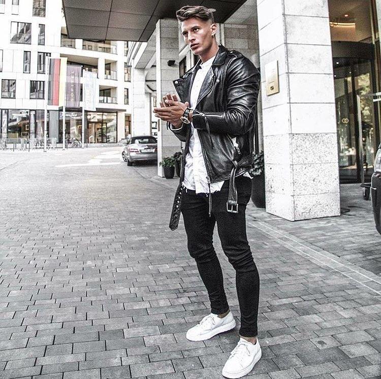 Black leather biker jacket, white shirt, black jeans and white sneaker