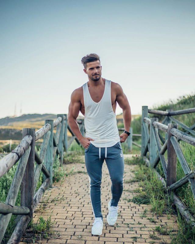 White singlet, sport pants, training shoes