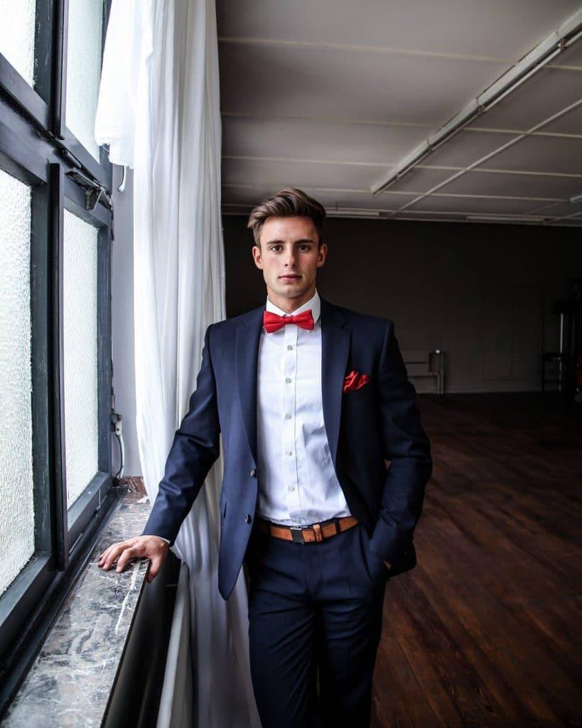 Blue suit, bow tie,