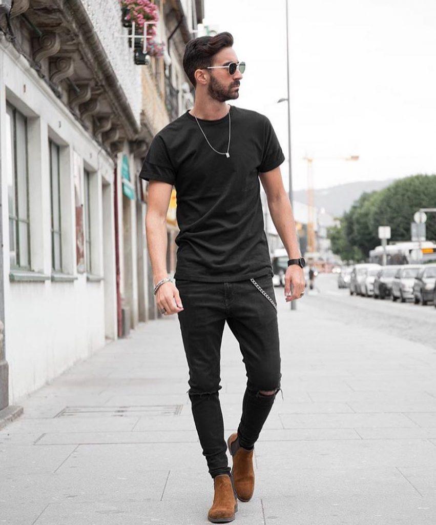 Black tee, black jeans, Chelsea boots